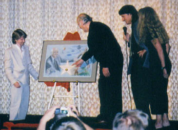 Mike Hansen and Ray Harryhausen unveil commemorative art.