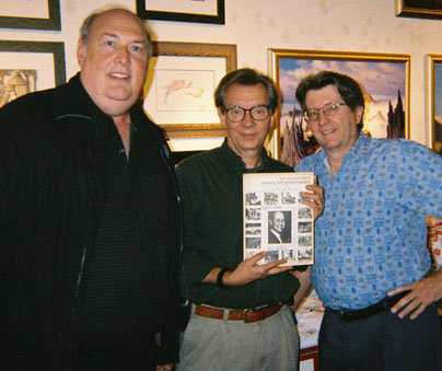 Sam Calvin and a Harryhausen fan and Ernest Farino pose with a copy of the first edition of their magazine FXRH.